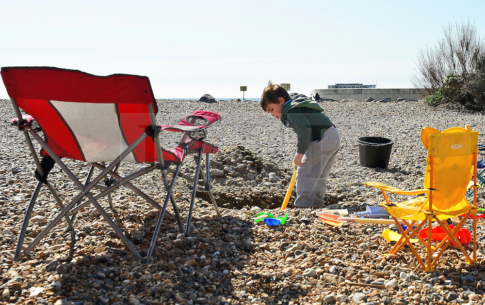 © under license to London News Pictures. 19/03/2011. Digging on the beach, enjoying the early spring sun in Worthing, West Sussex. Picture credit should read: Julie Edwards/London News Pictures