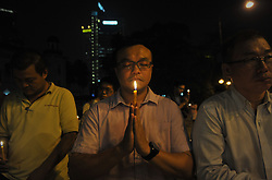 Men offer prayers during a candlelight vigil for passengers aboard a missing Malaysia Airlines plane in Kuala Lumpur, Malaysia, March 10, 2014. Malaysia Airlines flight MH370 with 239 people on board went missing early 08 March 2014 while on its way to Beijing, China. Malaysia will expand search and rescue operations to locate the missing Malaysia Airlines passenger jet with 239 people on board, as the third day of searching yielded no results, a senior Malaysian aviation official said,  Monday, 10th March 2014. Picture by Mohd FIrdaus / i-Images