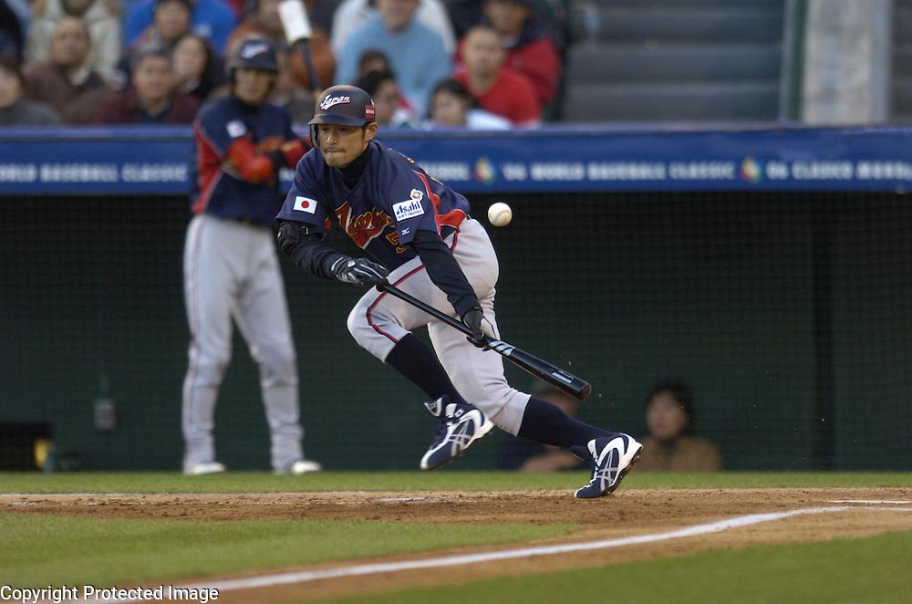 Team Japan's Ichiro Suzuki lays down a sacrifice bunt in the 3rd inning against Team Mexico in Round 2 action at Angel Stadium of Anaheim.