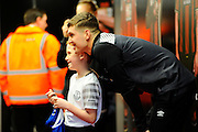Everton defender John Stones having a picture with a mascot before the The FA Cup match between Bournemouth and Everton at the Goldsands Stadium, Bournemouth, England on 20 February 2016. Photo by Graham Hunt.