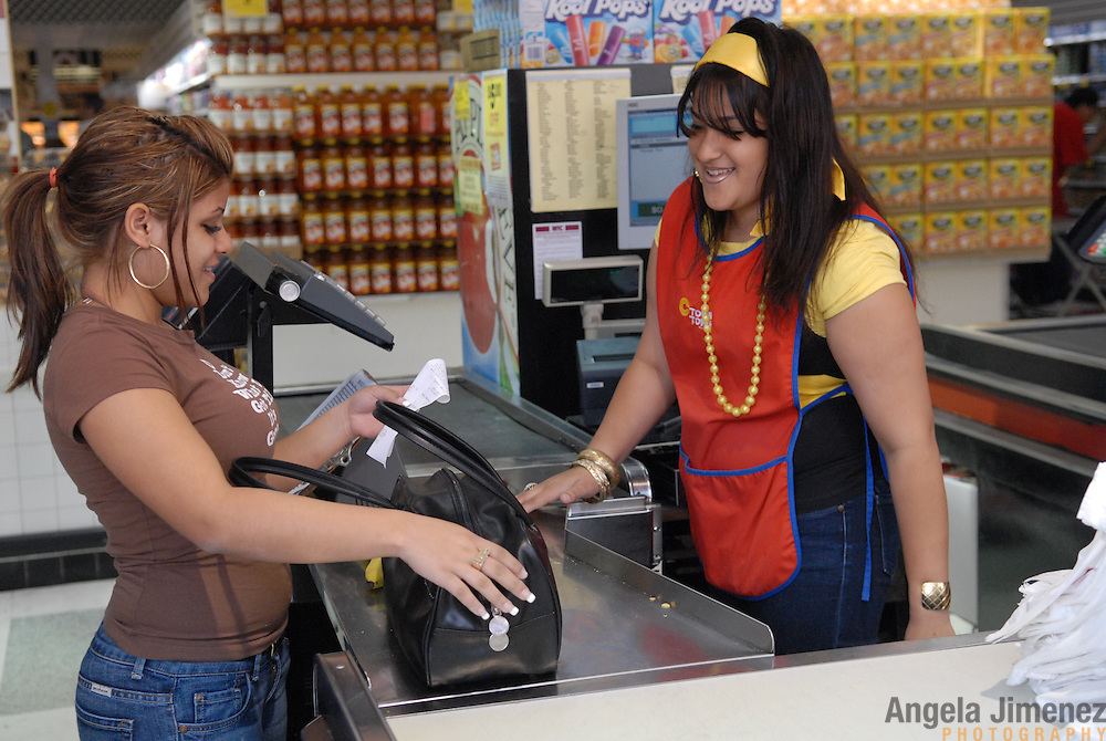 DATE: 6/7/07<br /> DESK: CTY<br /> SLUG: CTOWN<br /> ASSIGN ID: 30044113A<br /> <br /> Cashier Luzmarie Rolon, left, talks with cashier Krystal Leon, both 17,  as Rolon makes a purchase at Leon's register during a break from her shift at Steve's C-Town, a grocery store on 9th Street between 5th and 6th Avenues in Park Slope, Brooklyn on June 7, 2007. <br /> <br /> photo by Angela Jimenez for The New York Times<br /> photographer contact 917-586-0916