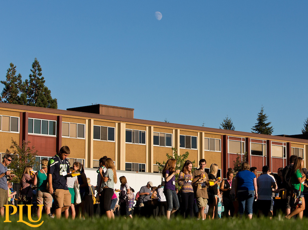 The moon above Foss at the outdoor dinner on move-in and orientation day at PLU on Thursday, Sept. 4, 2014. (Photo/John Froschauer)