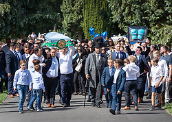 © Licensed to London News Pictures. 21/08/2018. Epsom, UK. Paddy Doherty (R) carries boxing gloves near the coffin at the funeral of traveller Mikey Connors in Epsom cemetery. 32 year-old Mikey Connors, the nephew of My Big Fat Gypsy Wedding star Paddy Doherty, was killed when his horse-and-cart was hit by a car in Thamesmead on July 28. Photo credit: Peter Macdiarmid/LNP