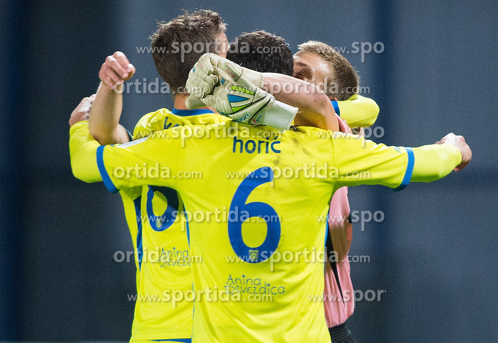 Players of Domzale and Nejc Vidmar #41 of Domzale celebrate after the football match between NK Domzale and ND Gorica in 10th Round of Prva liga Telekom Slovenije 2014/15, on September 24, 2014 in Sports park Domzale, Slovenia. Photo by Vid Ponikvar / Sportida.com