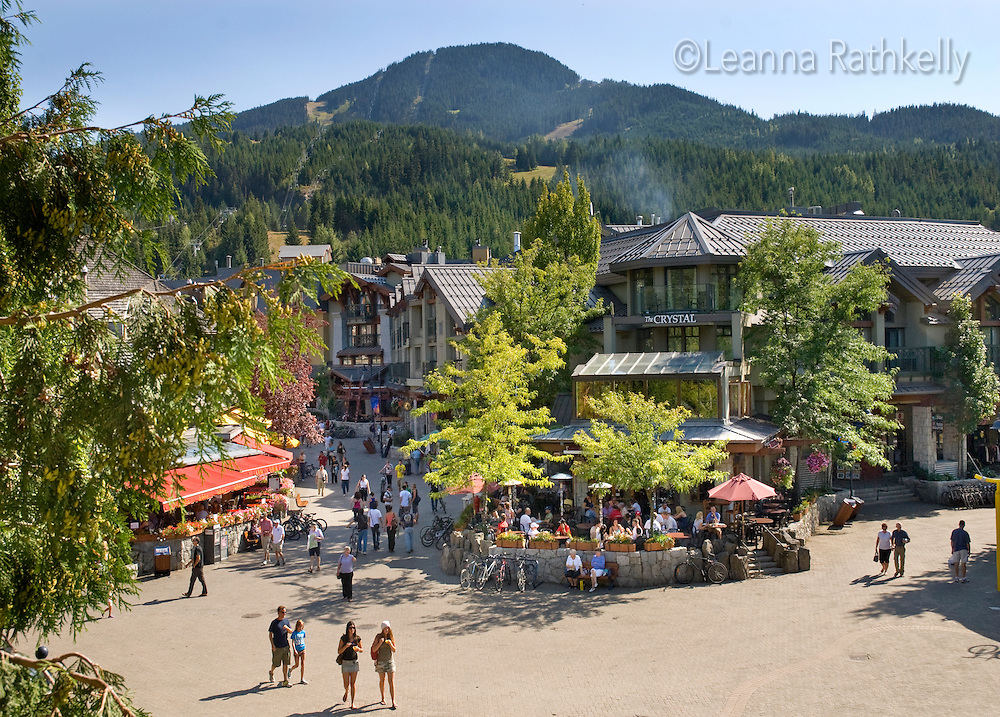 Visitors and residents wander the pedestrian-only Village Stroll in Whistler, BC during the summer