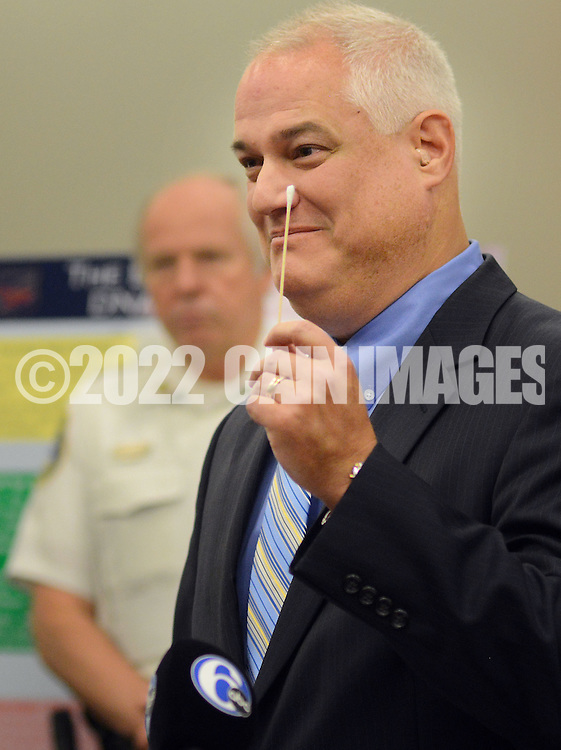"""Bucks County Assistant District Attorney and Chief of Prosecution Matthew D. Weintraub holds a DNA swab in the air while speaking about the launch of a new initiative in the field of DNA testing called """"BodeHITS"""", which is a Multi-Jurisdictional Countywide Local DNA Database program at the Bucks County Justice Center Tuesday October 6, 2015 at Doylestown, Pennsylvania. (Photo by William Thomas Cain)"""