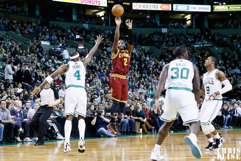 19 December 2012: Cleveland Cavaliers point guard Kyrie Irving (2) takes a jumpshot over Boston Celtics shooting guard Jason Terry (4) during the Boston Celtics 103-91 victory over the Cleveland Cavaliers at the TD Garden, Boston, Massachusetts, USA.