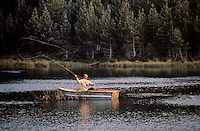 Prince Philip, Duke of Edinburgh fishing on a loch at Balmoral in September 1971