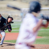 Navajo Prep Eagle Trevor Smith (2) pitches to a Tohatchi Cougar at the Gallup Sports Complex in Gallup Saturday.
