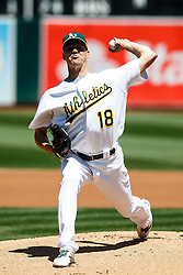 OAKLAND, CA - MAY 01:  Rich Hill #18 of the Oakland Athletics pitches against the Houston Astros during the first inning at the Oakland Coliseum on May 1, 2016 in Oakland, California. (Photo by Jason O. Watson/Getty Images) *** Local Caption *** Rich Hill