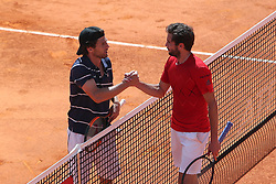 April 30, 2018 - Estoril, Portugal - Pedro Sousa of Portugal shakes hands with Gilles Simon of France during the Millennium Estoril Open ATP 250 tennis tournament - round 1, at the Clube de Tenis do Estoril in Estoril, Portugal on April 30, 2018. (Credit Image: © Pedro Fiuza/NurPhoto via ZUMA Press)