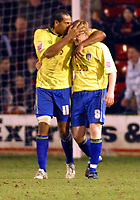 Photo: Dave Linney.<br />Walsall v Colchester United. Coca Cola League 1.<br />14/01/2006. <br />Colchester's Chris Iwelumo (L) plants a kiss on the head of    Gareth Williams after making it 2-0 to Colchester.