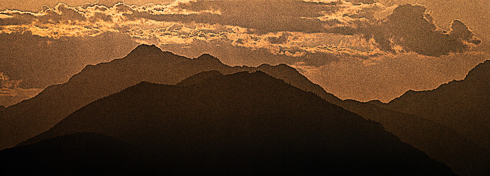 Mount Jupiter in the Washington state Olympic Mountains viewed from the Kitsap Peninsula in Puget Sound -silhouette sepia toned digital painting with reticulation texture panorama