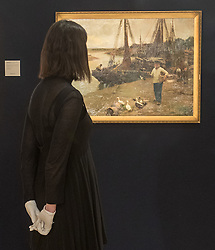 Bonhams, London, February 22nd 2017. Bonhams in London hold a press preview ahead of their 19th century paintings sale, featuring numerous valuable works including:<br /> • 'Children by the shore' by Dorothea Sharp, valued at £60,000-80,000<br /> • Barcas y pescaadores, Playa de Valencia by Joaquin Sorolla £60,000-80,000<br /> • When the Boats Come In by Walter Osborne valued at £100,000-150,000<br /> • A Solicitation by Lawrence Alma-Tadema which is expected to fetch between £30,000-50,000<br /> PICTURED: A gallery worker admires When the Boats Come In by Walter Osborne