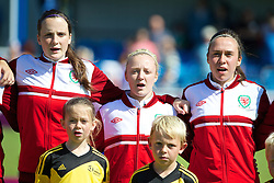 HAVERFORDWEST, WALES - Sunday, August 25, 2013: Wales' Alys Hinchcliffe, Lauren Hancock and Rhian Cleverly before the Group A match against France of the UEFA Women's Under-19 Championship Wales 2013 tournament at the Bridge Meadow Stadium. (Pic by David Rawcliffe/Propaganda)