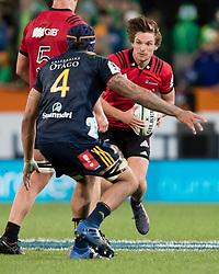 Crusaders' George Bridge, right, looks to beat Highlanders' Jackson Hemopo in the Super Rugby match, Forsyth Barr Stadium, Dunedin, New Zealand, Saturday, March 17, 2018. Credit:SNPA / Adam Binns ** NO ARCHIVING**