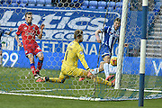 Oldham Athletic Goalkeeper, Joel Coleman makes himself big and stocks out a leg to stop a Wigan shot during the Sky Bet League 1 match between Wigan Athletic and Oldham Athletic at the DW Stadium, Wigan, England on 13 February 2016. Photo by Mark Pollitt.