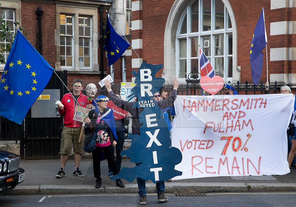 © Licensed to London News Pictures. 21/05/2019. London, UK. A brexit supporter wearing a UK shaped placard taunts pro-european demonstrators outside Olympia in London ahead of Brexit Party leader Nigel Farage's European Election Rally. Voters are due to go to the polls in two days. Photo credit: Peter Macdiarmid/LNP