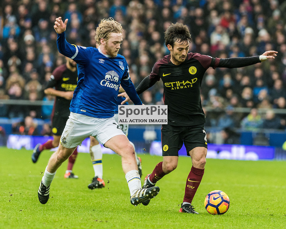Everton midfielder Tom Davies (26) and Manchester City midfielder David Silva (21) challenge for a loose ball in the Premier League match between Everton and Manchester City<br /> <br /> (c) John Baguley | SportPix.org.uk