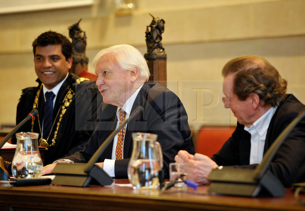 © Licensed to London News Pictures. 17/12/2013; Bristol, UK.  l-r: Lord Mayor of Bristol Cllr Faruk Choudhury, David Attenborough, Mayor of Bristol George Ferguson.  Bristol gives the city's highest honour to Sir David Attenborough at an extraordinary full council meeting on Tuesday, December 17.  Sir David Attenborough is widely recognised as the world's greatest natural history programme maker. The decision to award the Freedom of the City follows a close association between Bristol, the BBC's Natural History Unit (based in Bristol) and the renowned naturalist and film-maker. Freedom of the City will mean that Sir David Attenborough's name is added to the Roll of Honorary Freemen of the City. Sir David Attenborough's career as a naturalist and broadcaster has spanned nearly six decades and there are very few places on the globe he has not visited. 17 December 2013.<br /> Photo credit : Simon Chapman/LNP
