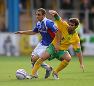 Carlisle - Saturday October 10th, 2008: Tom Taiwo (L) of Carlisle United and Simon Lappin of Norwich City during the Coca Cola League One match at Brunton Park, Carlisle. (Pic by Jed Wee/Focus Images)..