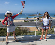 Proud American Waving the Flag Above Corona Del Mar Beach During Covid19 Government Shutdown