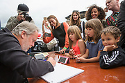 Artist and comedian Vic Reeves, does live drawing for £100 of a musician to one of their tracks at the 2017 Art Car Boot Fair, Folkestone, Kent. Here he is drawing Little Mix to their tune Black magic.  (photo by Andrew Aitchison / In pictures via Getty Images)