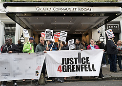 © Licensed to London News Pictures. 14/09/2017. London, UK. Protestors gather outside The Connaught Rooms on the first day of the public inquiry into the Grenfell fire. Police say they believe 80 people died in the tragedy. Photo credit: Peter Macdiarmid/LNP