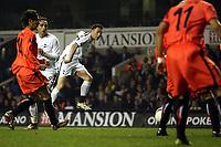 Photo: Paul Thomas.<br /> Tottenham Hotspur v Sevilla. UEFA Cup. Quarter Final, 2nd Leg. 12/04/2007.<br /> <br /> Robbie Keane of Spurs has this shot at goal deflect of team-mate Jermain Defoe, who claims the goal.
