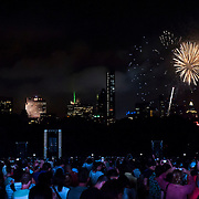 July 13, 2013 - New York, NY : People watch the fireworks from the Great Lawn in Central Park on Saturday evening after the New York Philharmonic's performance in the free MLB All-Star Charity Concert to benefit Hurricane Sandy victims on July 13, 2013.  Pop star Mariah Carey (not pictured) made a guest appearance. <br /> CREDIT: Karsten Moran for The New York Times