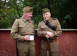 © Licensed to London News Pictures. <br /> 16/10/2016. <br /> Goathland, UK.  <br /> <br /> Two members of the Home Guard talk as they stand at Goathland station during the final day of the North Yorkshire Moors Railway Wartime Weekend event. <br /> The annual event brings together re-enactors and enthusiasts along the length of the NYMR heritage steam railway line to recreate the feel of the war years of the 1940's. <br /> <br /> Photo credit: Ian Forsyth/LNP