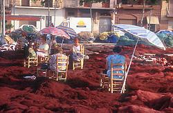 Women mending fishing nets at the docks in Tarragona; Catalonia Catalunya,