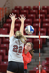 12 October 2013:  Ashley Rosch hits past Kayln Vlasin during an NCAA womens volleyball match between the Missouri State Bears and the Illinois State Redbirds at Redbird Arena in Normal IL