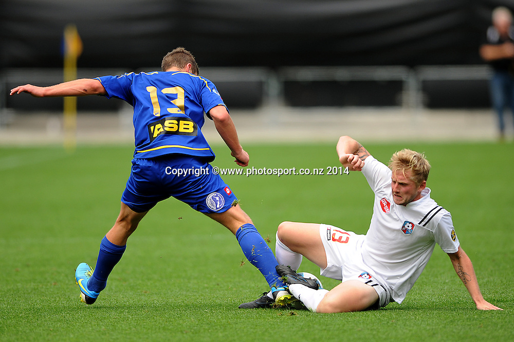 Logan Wright-Webb of Southern United gets caught in the tackle of Ben Latham of WaiBOP during the ASB Premiership Football match between Southern United and WaiBOP United at Forsyth Barr Stadium, Dunedin, New Zealand, February 9 2014. Credit: Joe Allison / www.photosport.co.nz
