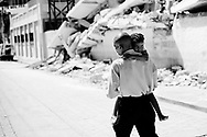 Haiti Earthquake, Port au Prince.<br /> A father carry his daughter to the hospital with a broken foot.