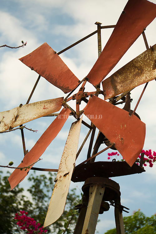 ANTON, PANAMA - FEBRUARY 15: An old wind mill stands in the yard of a house in Anton. February 15, 2010. Anton, Panamá. (Photo: Ruben Alfu / Istmophoto)