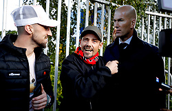 Manchester United fans with a life size cutout of Zinedine Zidane outside the ground before the Premier League match at Old Trafford, Manchester.