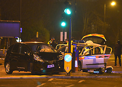 © Licensed to London News Pictures. 17/01/2013. London, UK A collision between a police car and a car at the junction of Askew Road and Uxbridge Road in West London on the evening of 17th January 2013. Road closures and diversions were in place. Photo credit : Stephen Simpson/LNP