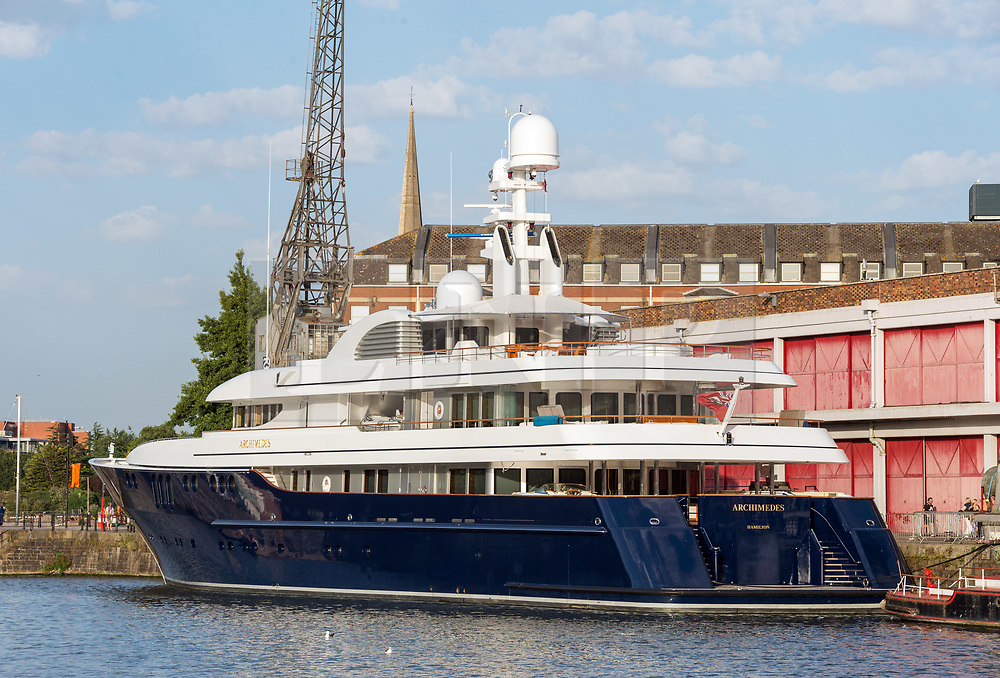 © Licensed to London News Pictures. 06/08/2018. Bristol, UK.  The Archimedes super yacht pictured on a summer evening visiting Bristol's floating harbour for a few days mooring alongside the M Shed museum. The yacht is worth an estimated £75million and is believed to be owned by US billionaire James 'Jim' Simons, a hedge fund manager based in New York City. As reported by Forbes, his net worth as of February 2018 is estimated to be $20 billion. He is not believed to be on board the yacht currently. The 80-year-old American is a former mathematics professor and subsequent chair of the mathematics department at Stony Brook University, and went on to found Renaissance Technologies, a hedge fund firm which is worth an estimated £64billion. The yacht, which flies a Bermuda flag, is 68 metres in length and is staffed by 18 members of crew. It is not known why the yacht is visiting Bristol. Photo credit: Simon Chapman/LNP