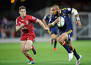 Patrick Osborne steps James O'Connor of the Reds. Investec Super Rugby - Highlanders v Reds 27 February 2015, Forsyth Barr Stadium, Dunedin, New Zealand. Photo: New Zealand. Photo: Richard Hood/www.photosport.co.nz