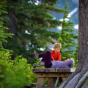 Kids have a private conversation on a picknick table near Heather Meadows and the Mount Baker Ski Area Washington.