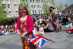 Plymouth, UK  29/04/2011. The Royal Wedding of HRH Prince William to Kate Middleton. A young girl with a painted face watches the wedding unfold in Plymouth city centre. Photo credit should read London News Pictures. Please see special instructions. © under license to London News Pictures