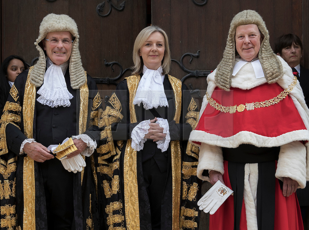© Licensed to London News Pictures. 21/07/2016. London, UK. Newly appointed Justice Secretary Liz Truss is officially sworn in as Lord Chancellor of Great Britain here flanked by Master of the Rolls, Lord Dyson (L) and The Lord Chief Justice , Lord Thomas at the High Court.  Justice Secretary Liz Truss replaces Michael Gove who was sacked from the cabinet by new Prime Minister Theresa May. Photo credit: Peter Macdiarmid/LNP