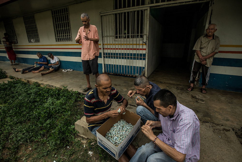 "BARQUISIMETO, VENEZUELA - AUGUST 25, 2016: Patients pick at blocks recycled material, breaking it into small pieces for hours a day. It is a low cost form of therapy that doctors at El Pampero invented to help psychiatric patients relieve their anxiety. Before the crisis, when patients were receiving all the medicines they needed - and the hospital had healthy government funding, they had a much more robust therapy program.  They held weekly sewing, cooking, and sculpture classes.  They had a farming program where patients grew fresh vegetables, and a sports program.  Now, there is no funding for any sort of therapy except picking at the blocks of recycled material, and unmedicated patients are too unstable to do those types of activities anymore.  ""When patients have their medicines, they can do really complex crafts. Now they just do simple tasks,"" said art therapist Mirthis Fernández.  PHOTO: Meridith Kohut for The New York Times"