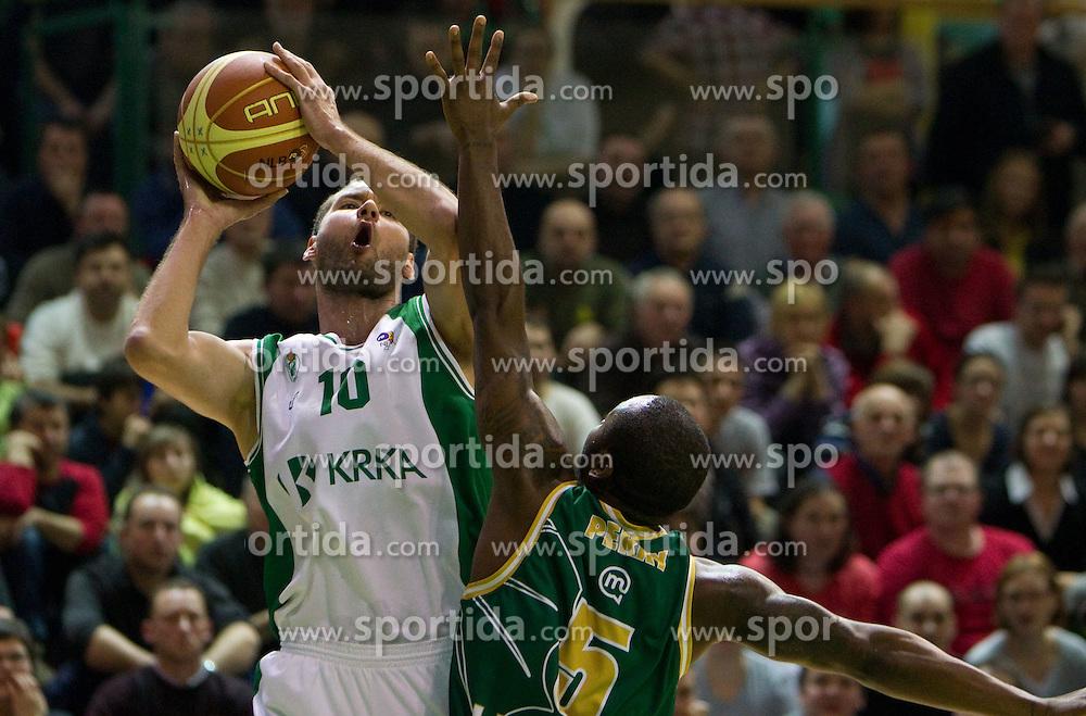 Dusan Djordjevic of Krka vs Marque Perry of Olimpija during basketball match between KK Krka (SLO) and Union Olimpija (SLO) in 16th Round of NLB Adriatic League, on January 11, 2011 in Arena Leona Stuklja, Novo mesto, Slovenia. (Photo By Vid Ponikvar / Sportida.com)