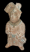 Mayan priest holding a knife and a fan. Earthenware, Maya, Mexico 600-900 AD