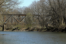 A steel beam railroad trestle spans the Mackinaw River in central Illinois