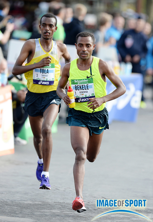 Apr 6, 2014; Paris, France; Kenenisa Bekele (ETH) and Tamirat Tola (ETH) lead the Schneider Electric Marathon de Paris. Bekele won in a course record 2:05.03 in his marathon debut. Photo by Jiro Mochizuki