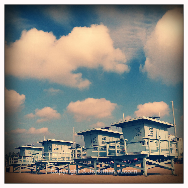 Puffy clouds and Lifeguard towers on Venice Beach