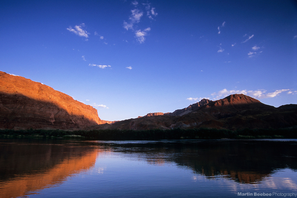 Evening alpenglow on cliff above the Colorado River, Lee's Ferry, Glen Canyon National Recreation Area, Arizona